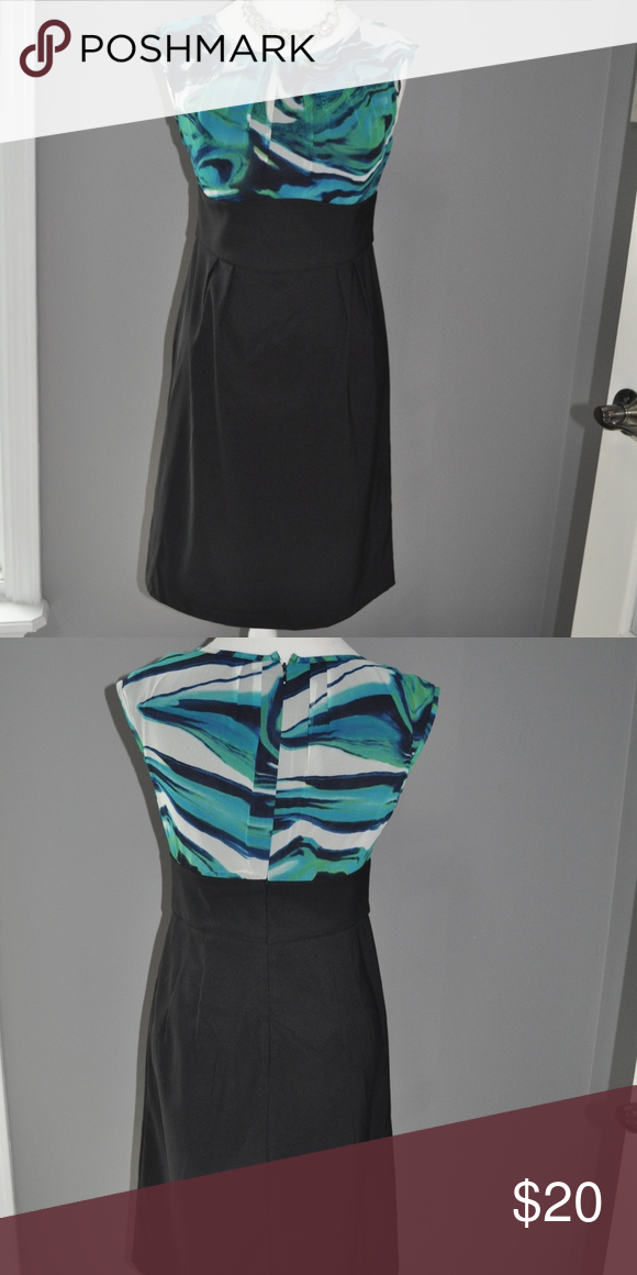 Floral top dress Bodice hues of blue, green and white Skirting of dress in black Scoop neck top with pleating Black waistband Zipper closure on back  Dress comes right above the knee Gently used - only worn once AB Studio Dresses Midi