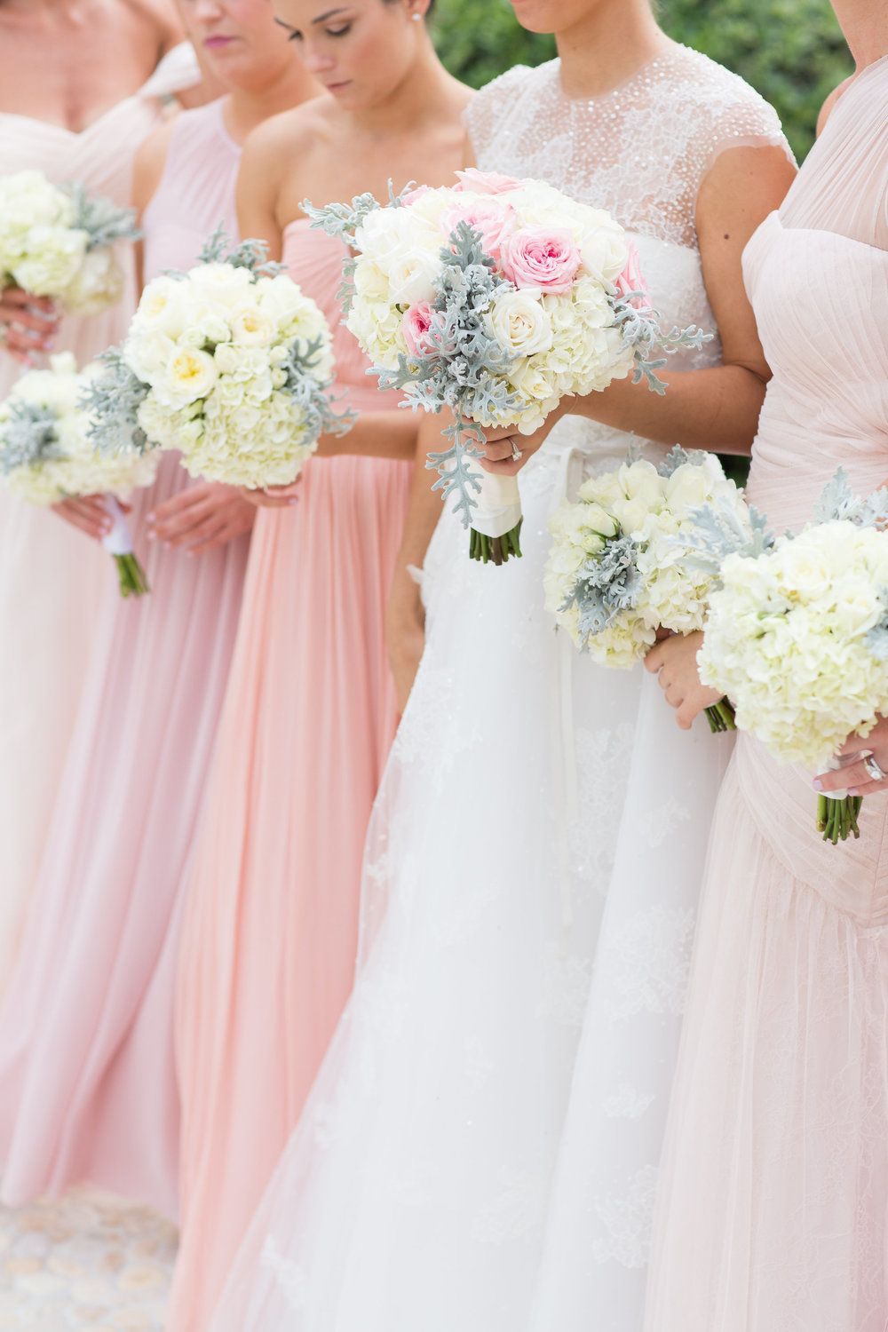 A bride's color scheme often inspired the gift box. Bride Jessica chose blush bridesmaids dresses and fabulous white and blush bouquets with touches of lambs ear. Leah Taylor prepared a seaside box to welcome wedding guests to the wedding weekend.