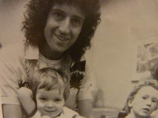 OMG!!!....Brian May and his son  Jimmy...and behind them is John son...cute