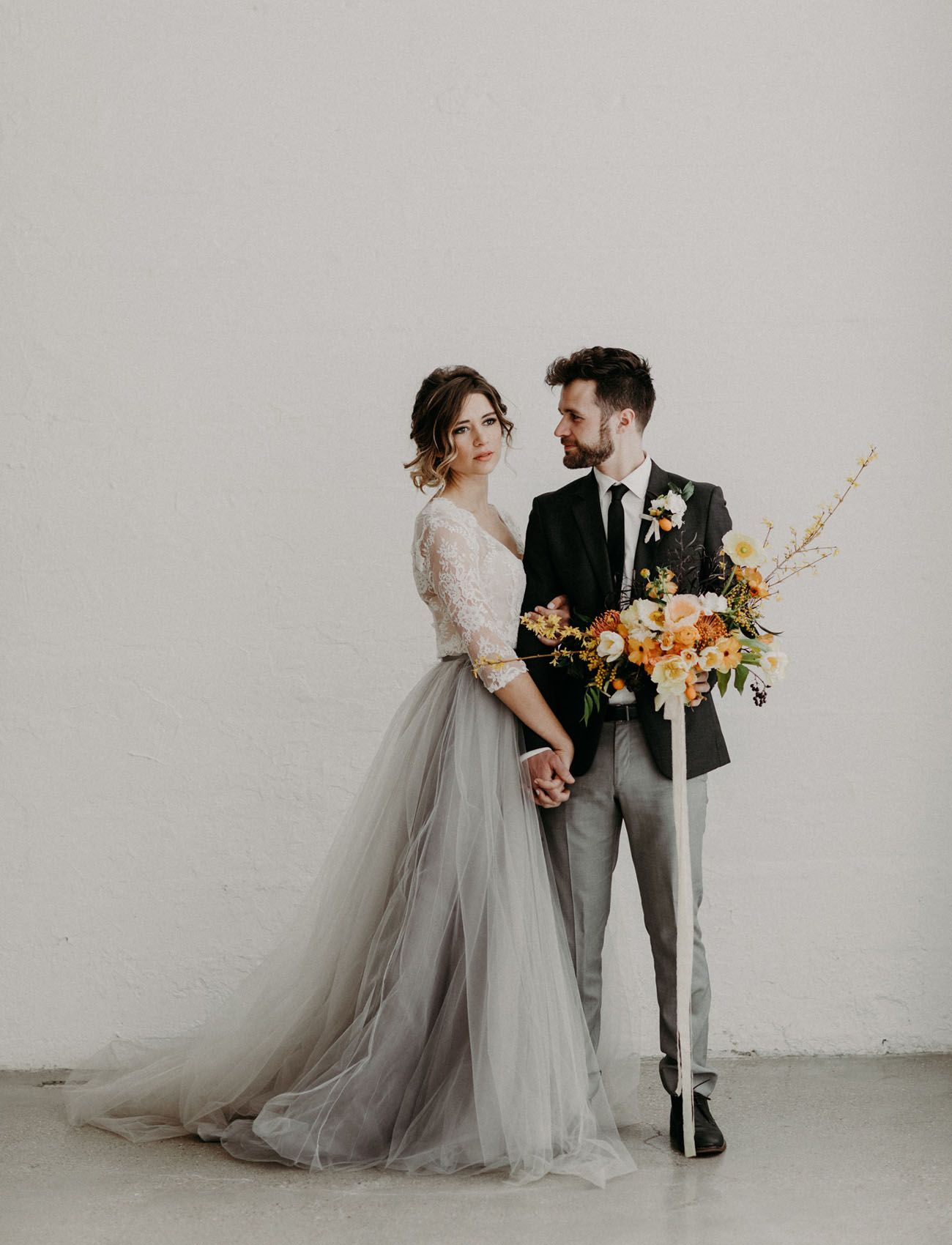 modern + moody wedding inspiration featuring a gray tulle skirt
