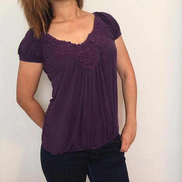 Purple Rosette Top Beautiful purple loose fit tip with rosette designs at neckline. Cinched hem gives bubble top effect. Short sleeves. •CN06021614• Soprano Tops
