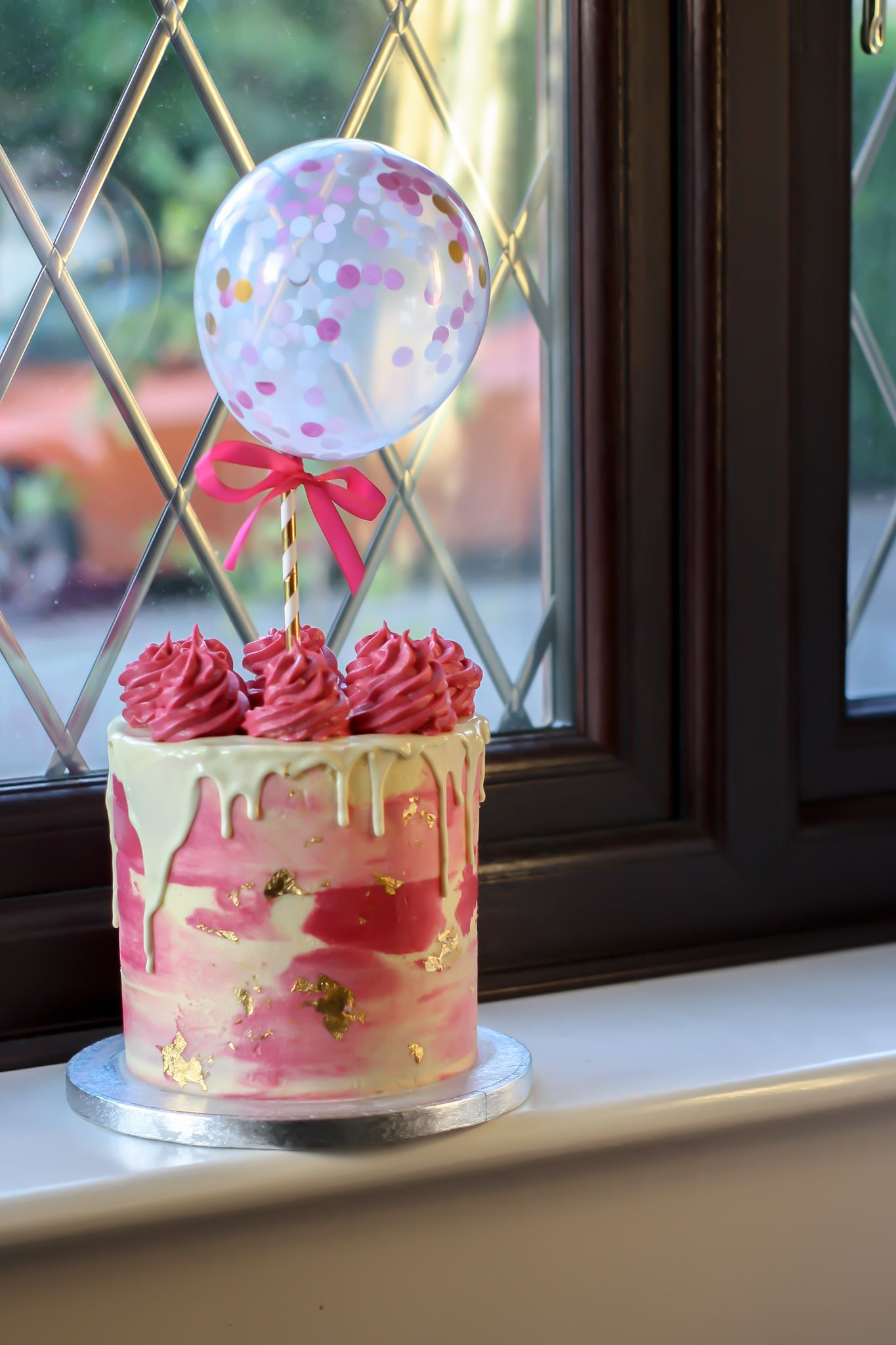 Single tiered pink ombre water coloured birthday cake