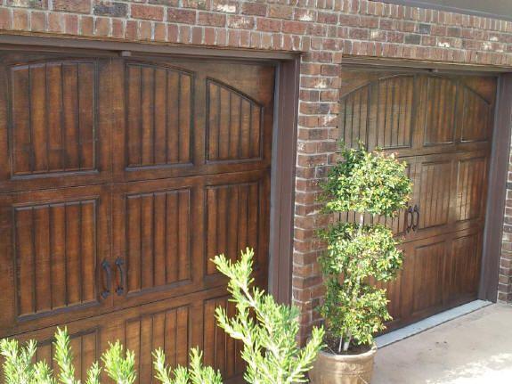 Faux wood finish on metal garage doors