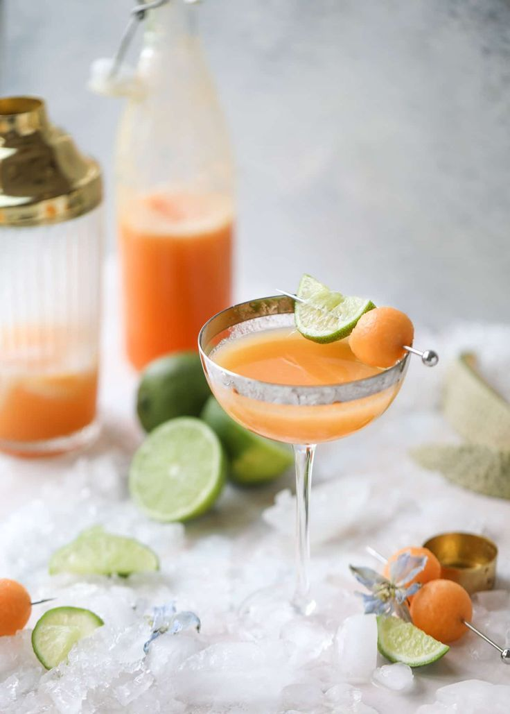 This cantaloupe daiquiri is the perfect way to celebrate summer! Freshly juiced melon, lime juice, rum and maraschino cherries - it's refreshing and cool and a fantastic cocktail to have during happy hour! Isn't the color amazing too?! I