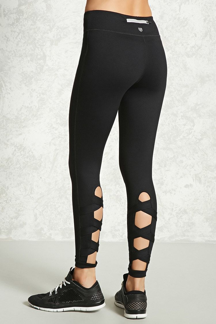 daaacb68c7 A pair of stretch knit athletic leggings featuring a crisscross strappy  cutout design, hidden back key pocket, and moisture management.
