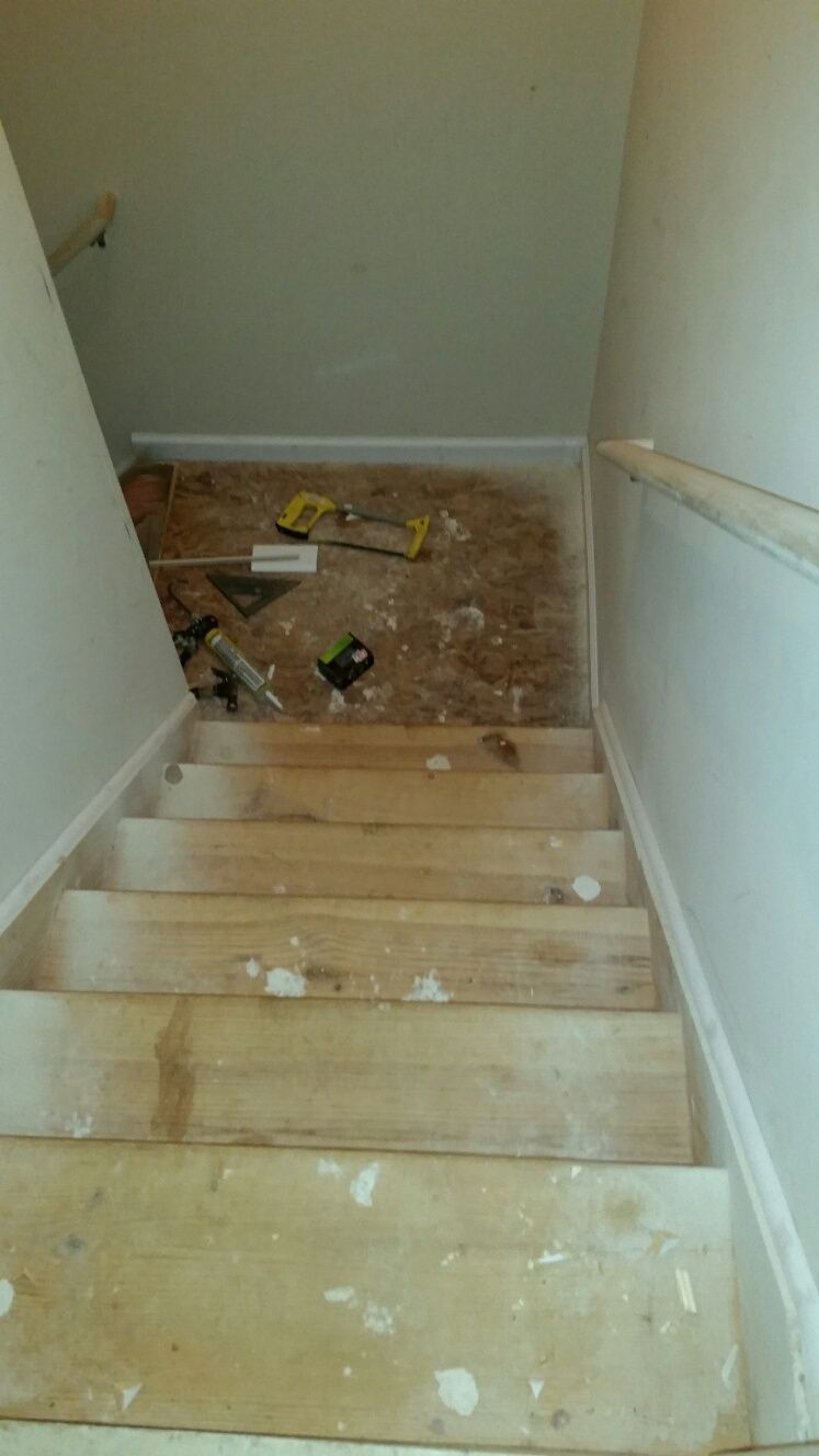 Before photo stairs leading to unfinished basement
