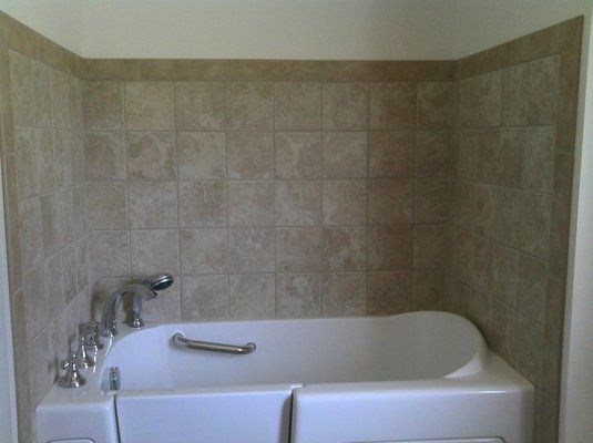 bathtub surrounds that look like tile | Specialty Tub with ...
