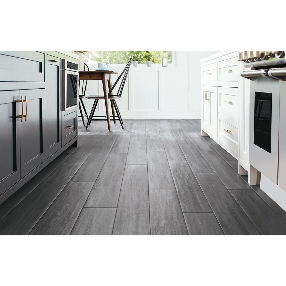 Home Decorators Collection Briar Hill Oak 12 Mm Thick X 7 9 16 In W X 50 5 8 In L Water Resistant Laminate Flooring 15 95 Sq Ft Case 51149 The Home Depo In 2020 Laminate Flooring Flooring Home Decorators Collection