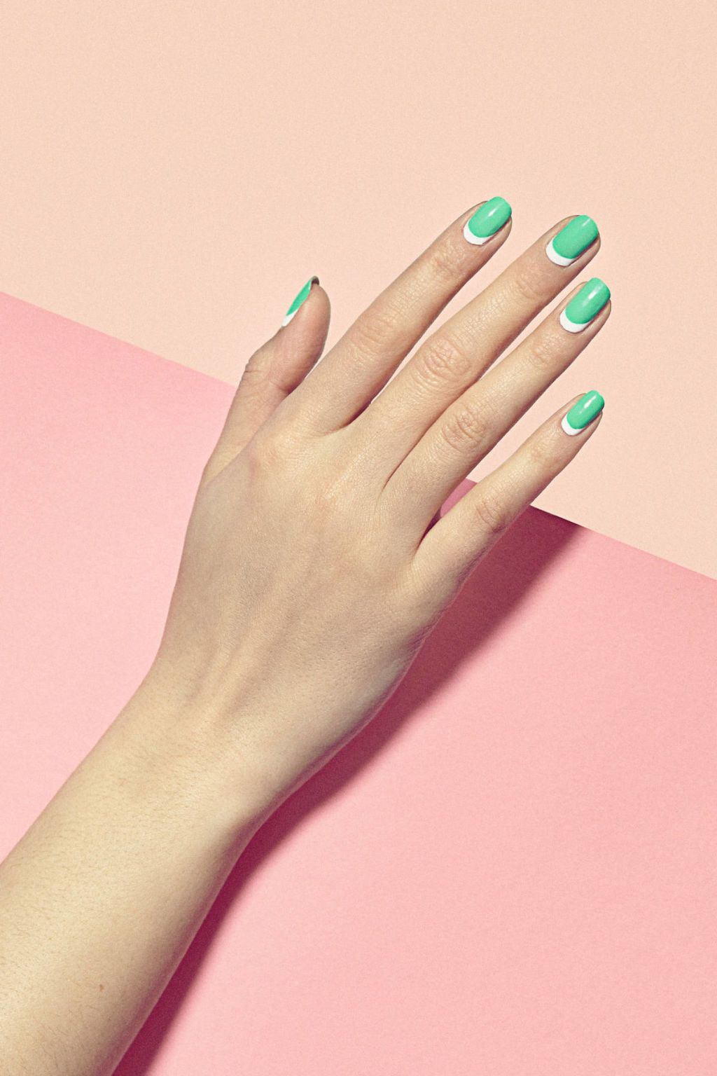 """It's the new way to do a moon manicure,"" says Julie Kandalec, Creative Director of Paintbox. And there's a reason why it's more visually exciting: ""The white base makes the other bright colors really pop from the contrast, and the moon shape comes to a super chic point at the corners (instead of a curve which can read too precious),"" she explains.  WHY YOU'LL LOVE IT: ""This look is for the woman who likes a subtle, chic contrast."" says Kandalec. THE PAINTBOX HOW TO: 1. Apply a white base…"