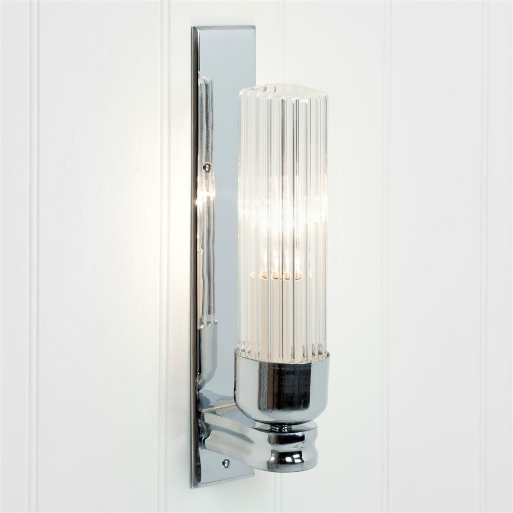 brighten up your bathroom with a stylish bathroom light hand crafted in solid brass with a fluted glass shade available antiqued painted or nickel plated