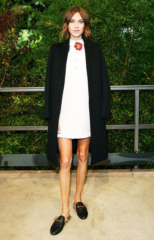 8ced865dc6a6 Alexa Chung wears a white dress with an open black sweater and Gucci  leather slippers.