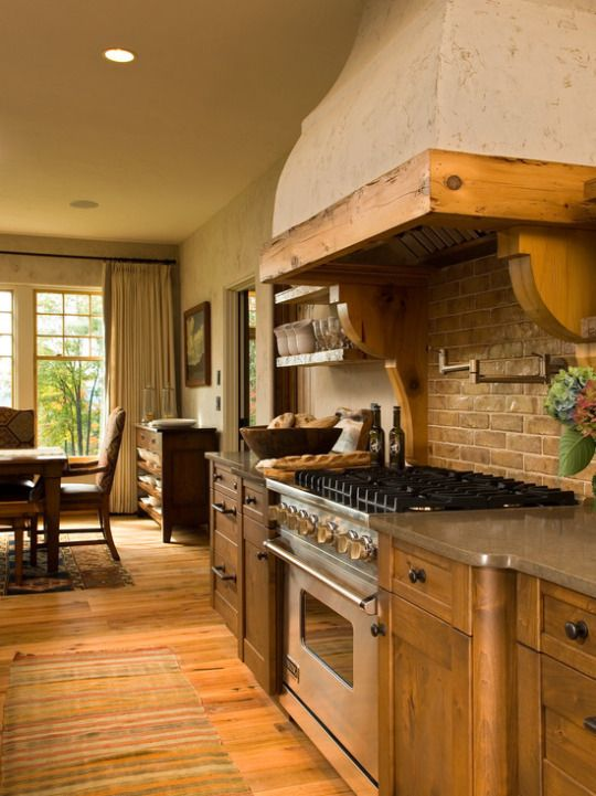 Rustic Country Style Kitchen With Unique Range Hood And
