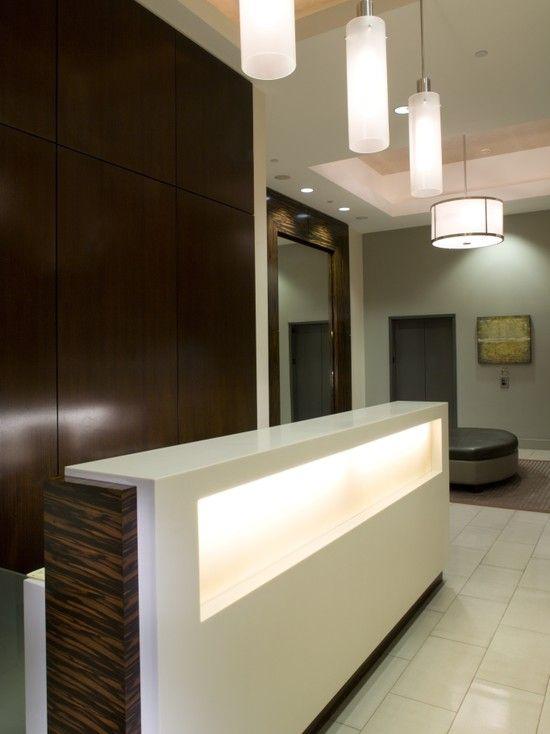 sleek reception  CLIENT EEC  Hotel reception desk