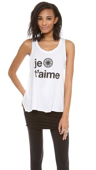 5e0a6a431 The perfect workout layer, this flared SoulCycle tank has 'Je t'Aime'  lettering and a wheel graphic. Unfinished edges. $64.00 on @Keaton Row  website, ...