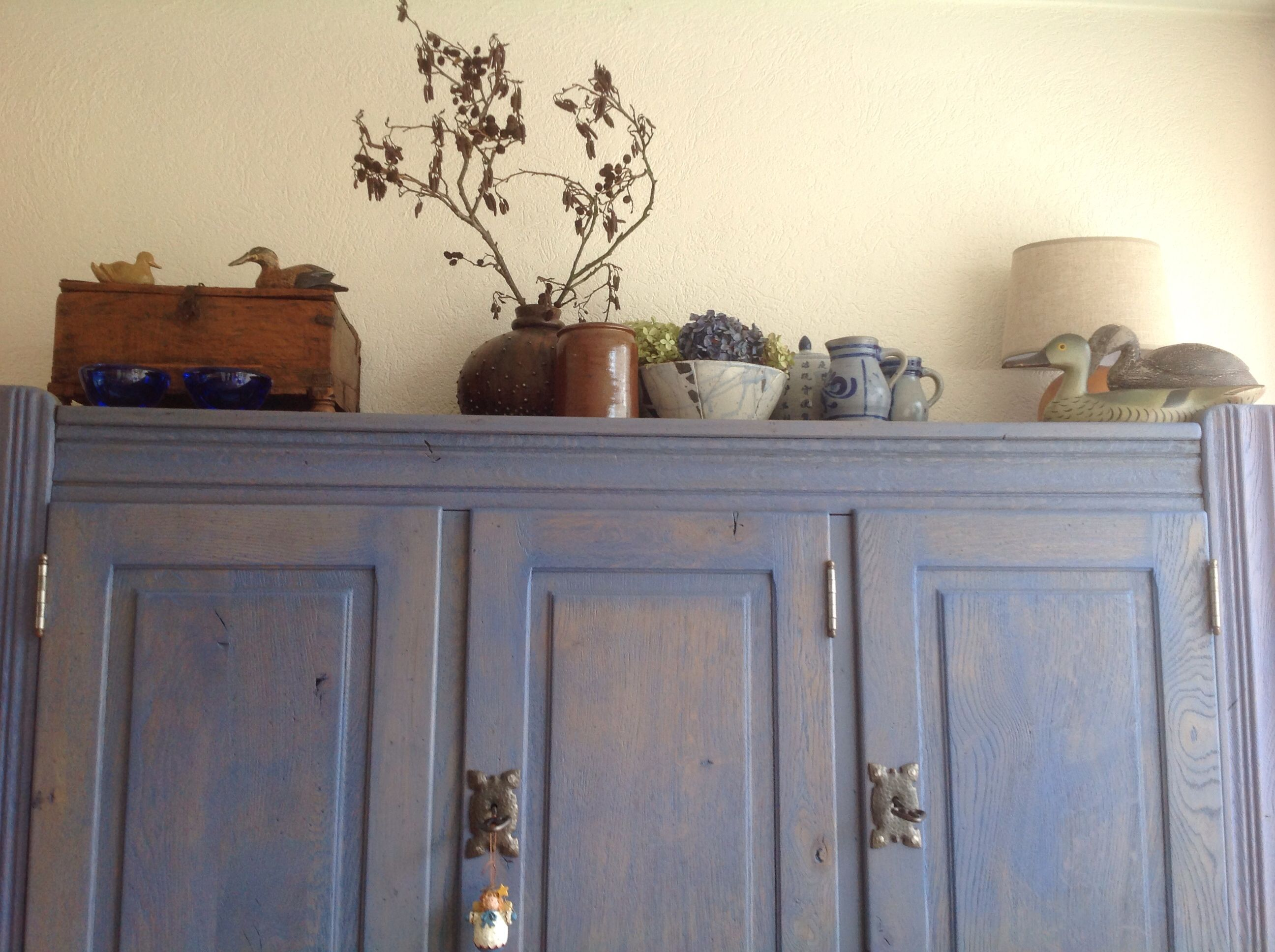 Decoratie bovenop de kast over cabinet decor