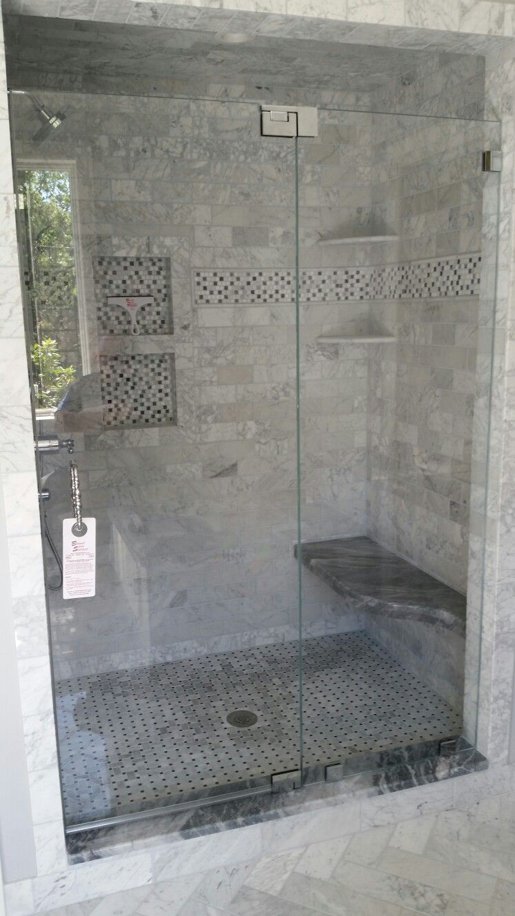 Frameless shower door off fixed panel with 1/2