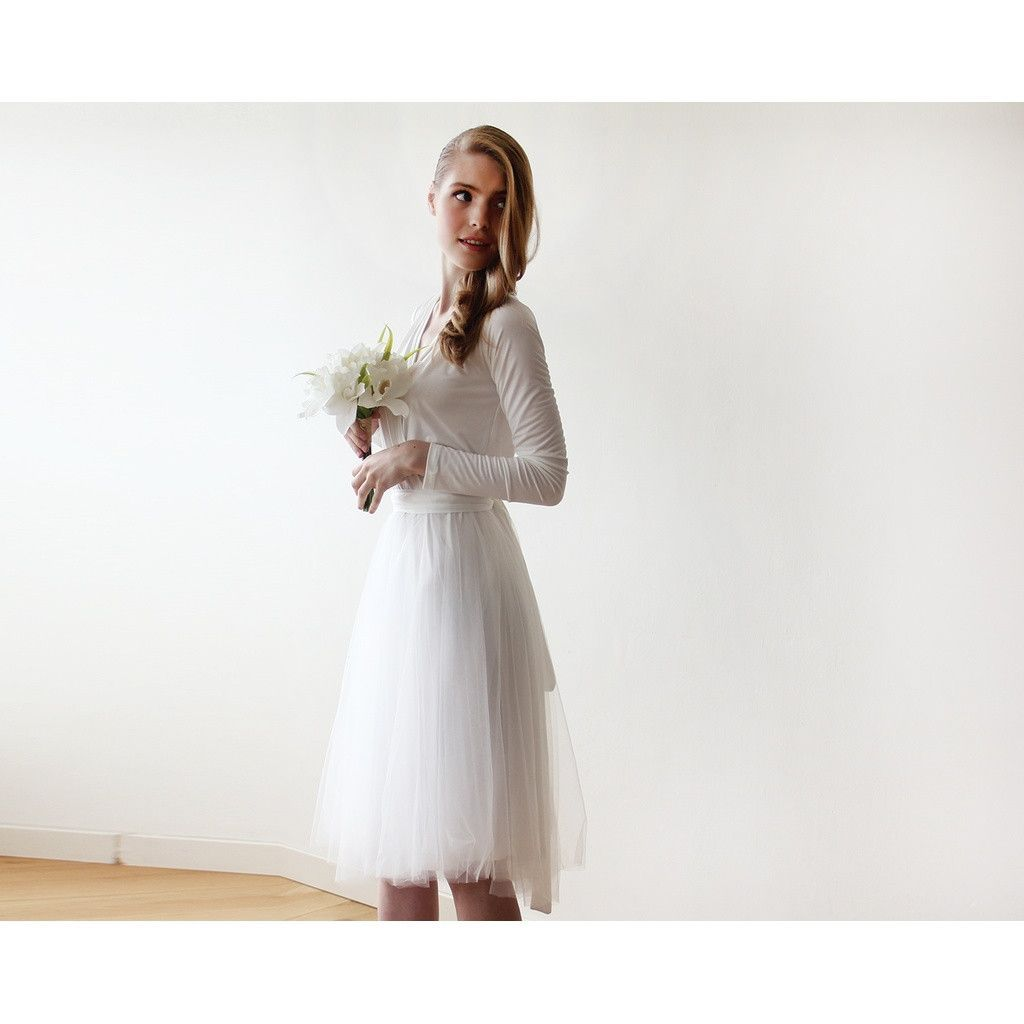 Black midi length tulle gown with long sleeves black bridesmaids