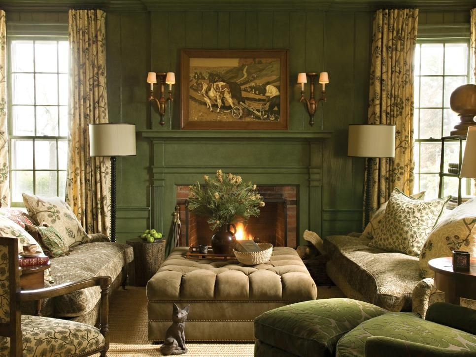 This Cozy Sitting Room Is Furnished With Overstuffed Seating Around The Brick Fireplace Hunter Green Walls Fl Textiles And A Bucolic Painting