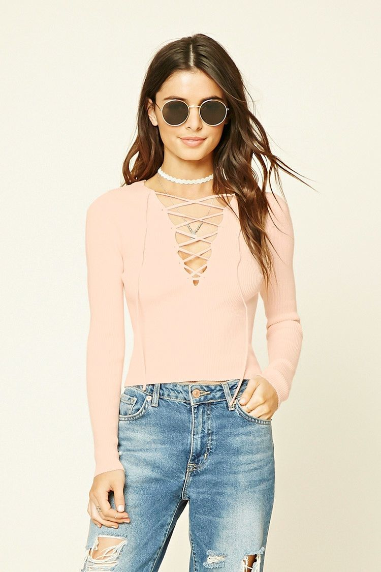 0164b1353d A ribbed knit top featuring a crisscross lace-up front