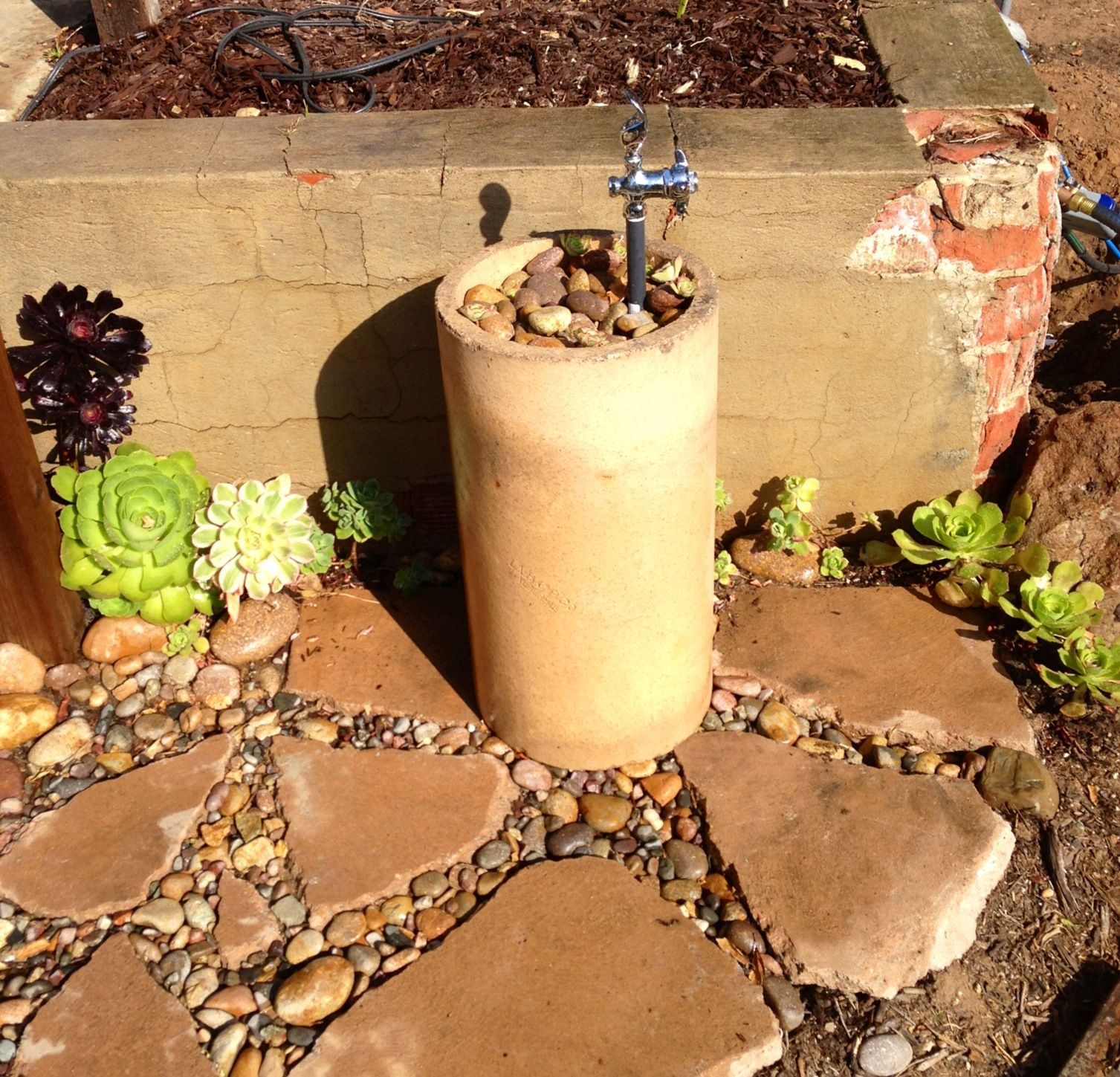 Backyard Drinking fountain - no more kids running into the house for a drink  - upcycled chimney flue section, broken concrete and cobble. - Backyard Drinking Fountain - No More Kids Running Into The House For