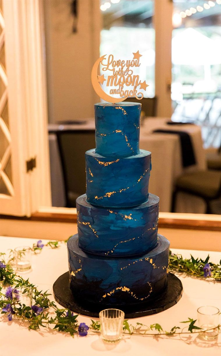 Blue and gold four tier wedding cake topped with love you to the moon and back #weddingcake