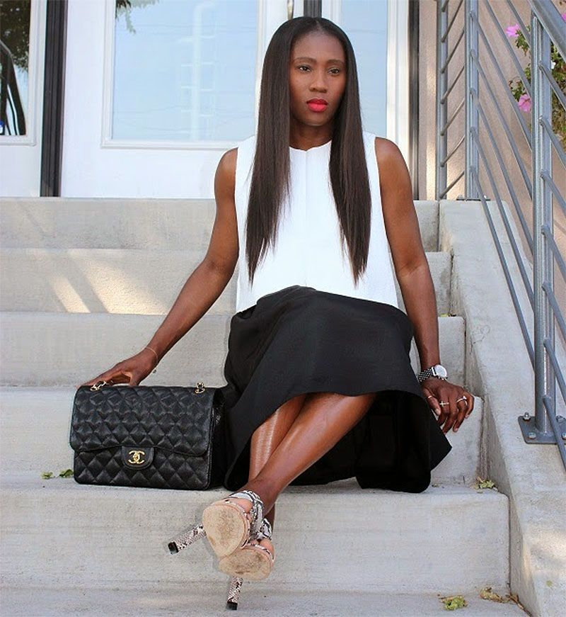 60993843c984c4 Ranti Onayemi Chanel classic flap bag gold black white outfit sitting on  steps