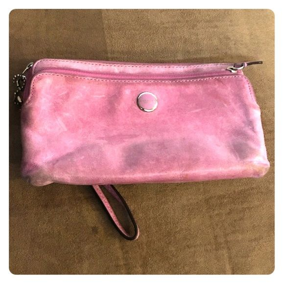 Coach Wallet/Clutch It's worn some from use, just needs some TLC. I've always loved the color and the leather is super soft. Coach Bags Clutches & Wristlets