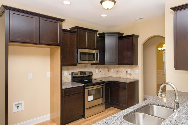 Kitchen With Granite Countertops And Staggered Cabinets In Riddick