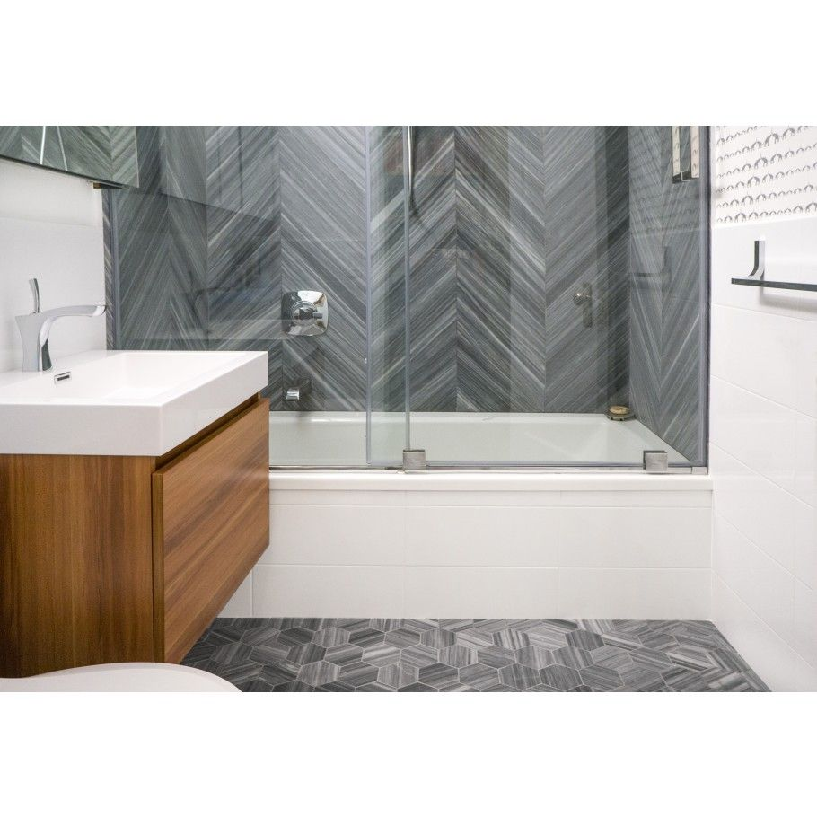 milan gray chevron l honed marble tile tilebar com a room with
