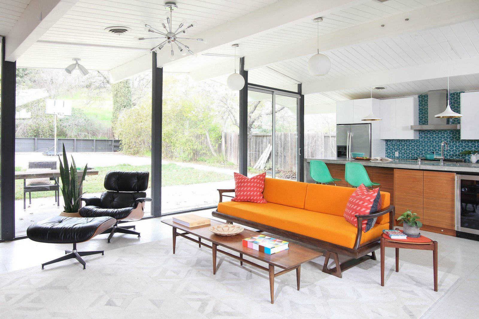 Modern home with living room sofa ceiling lighting end tables vinyl floor and chair vintage furniture collected through local estate sales and antique
