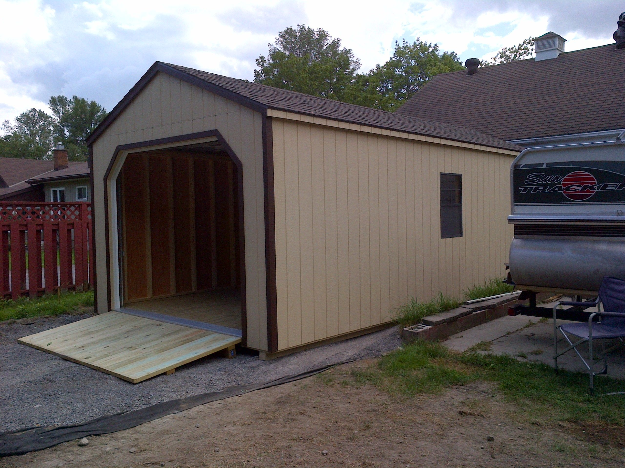 12' X 20' Wooden Portable Garage - Delivered Fully Assembled and Ready for Immediate Use near Belleville ON...Visit NorthCountrySheds.com for more info..