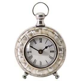 """Desk clock with a mosaic frame. Product: Desk clockConstruction Material: Aluminum and glassColor: SilverFeatures:   Stylish yet sophisticatedShell inlayA traditional clock face with Roman numerals   Dimensions: 5.75"""" H x 5"""" W x 3"""" DNote: Batteries not included"""