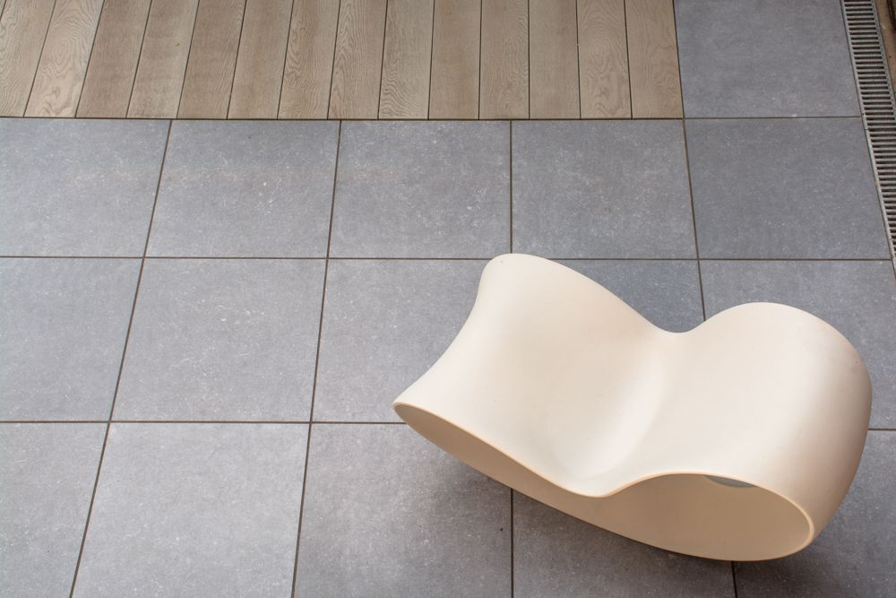 Porcelain paving and millboard composite decking by robert hughes