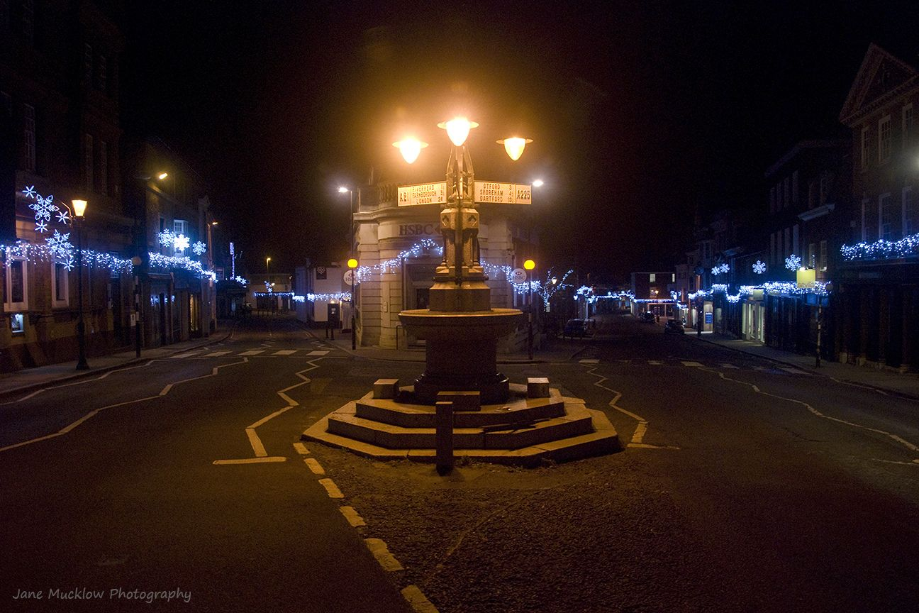Sevenoaks High Street and signpost, with Christmas lights
