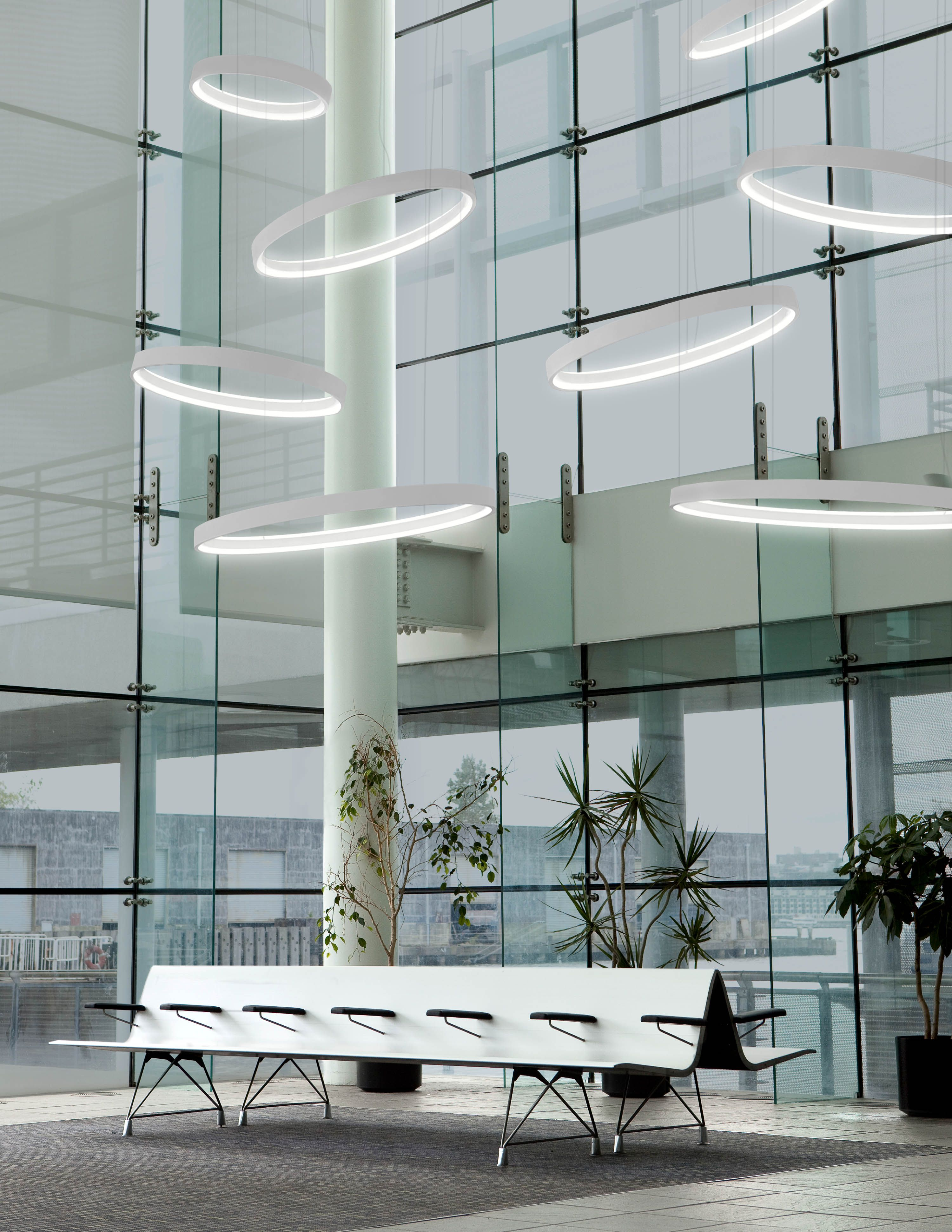 Cascading circular pendants of varying sizes in high ceiling atrium ...