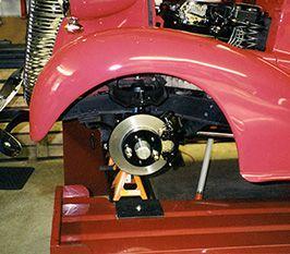 Danny Johnson Photo Garage Lift Lifted Cars Restoration Shop