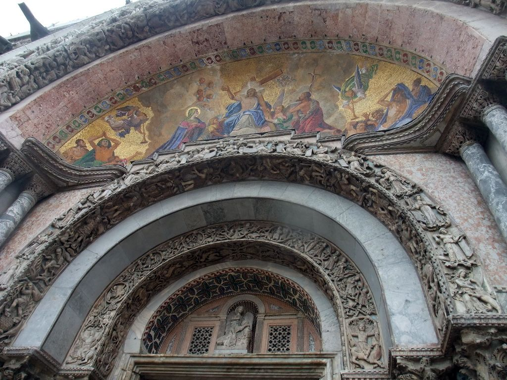 Paintings and reliefs above the main portal of the Basilica di San Marco church