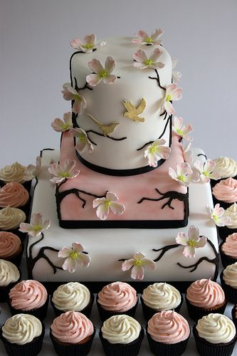 Dogwood Blossom Wedding Cake with Cupcakes by ConsumedbyCake, via Flickr. Gorgeous!