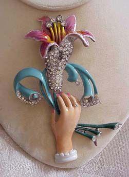 Staret enamel & rhinestone hand flower pin