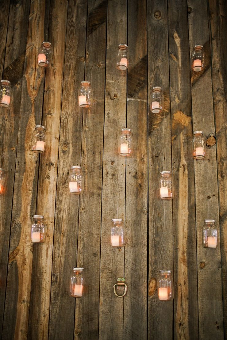Candle in mason jar on the wall as wedding decorations | fabmood.com