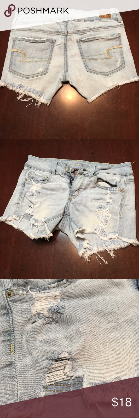 American Eagle Size 4 Distressed Shorts Size 4. American Eagle jean shorts (stretchy). They are distressed with holes and fringe on the bottoms. They have a little bit of wear but still lots of life! American Eagle Outfitters Shorts Jean Shorts