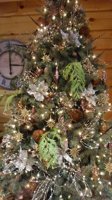 Add some fresh evergreen to your faux tree for that scent of Christmas