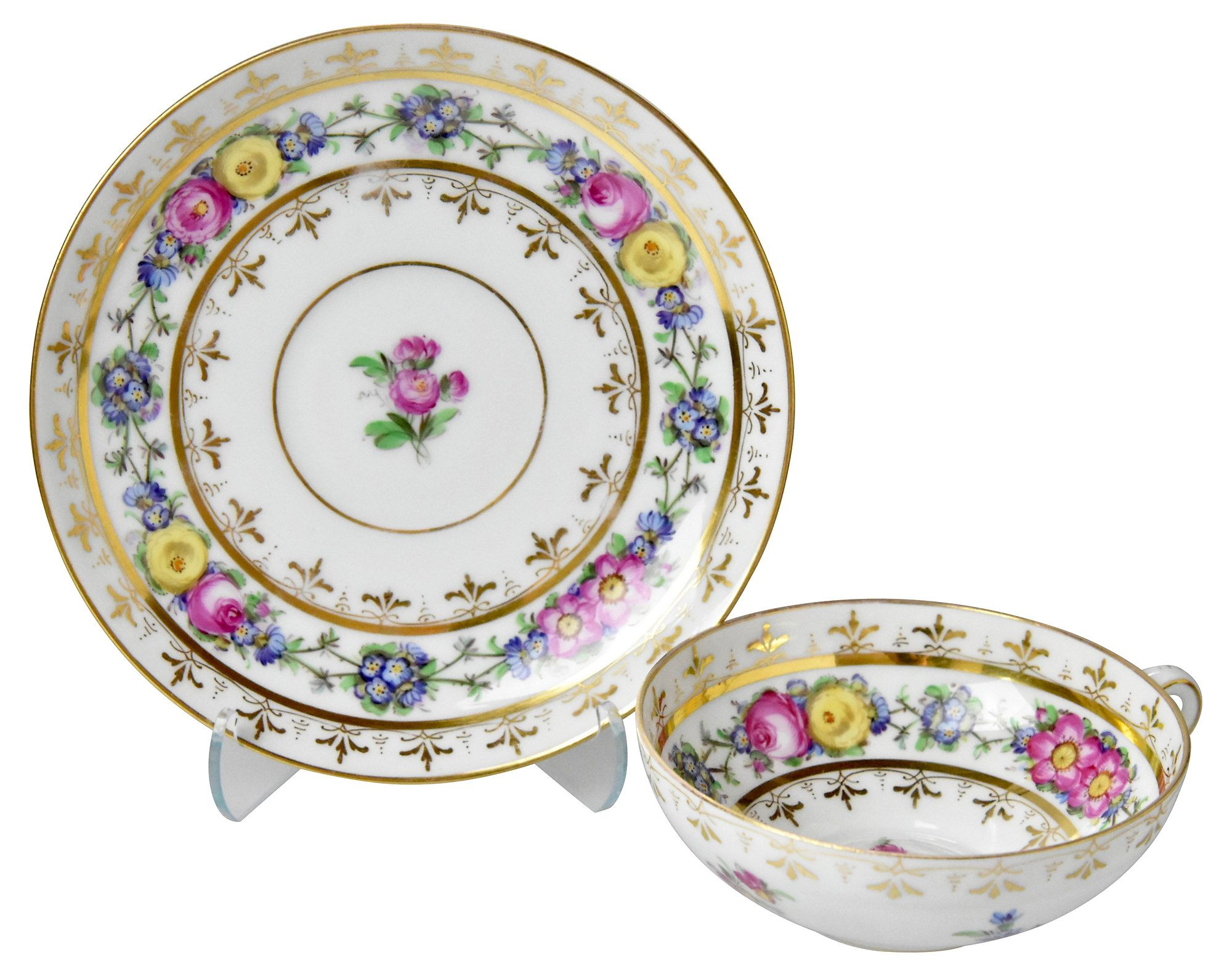 Set of 12 Dresden cups and saucers, embellished with entirely hand-painted floral designs and hand-gilded accents, expertly decorated at the studio of Ambrosius Lamm in Dresden. Marked with blue...