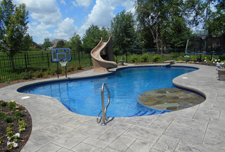 Family Fun Starts Here With This Free Form Swimming Pool With Basketball Hoop Tanning Ledge Divin Luxury Pools Backyard Pools Backyard Inground Backyard Pool
