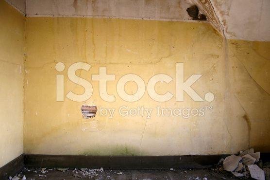 Yellow Crumbling Water Damaged Plaster Walls And Floor Plaster Walls Flooring Water Damage