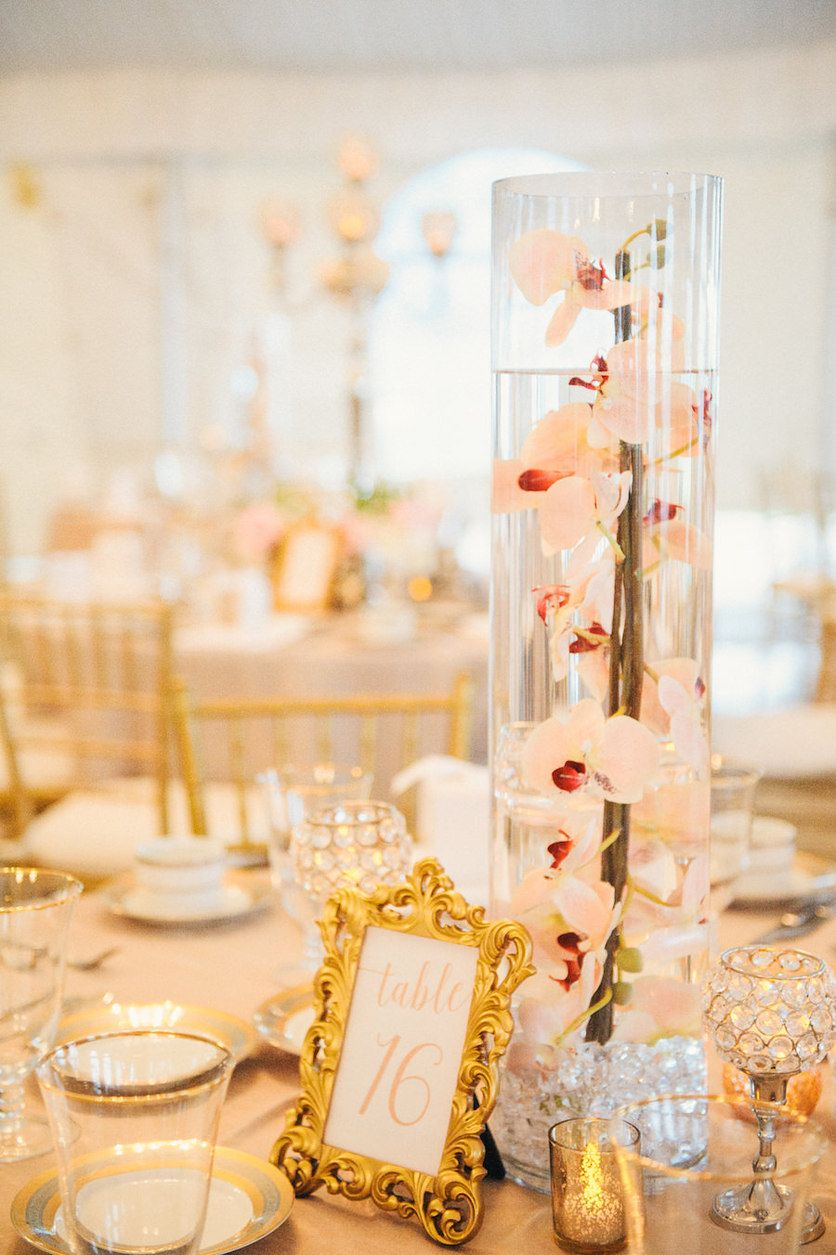 Blush and gold wedding reception with tall submerged orchids in blush and gold wedding reception with tall submerged orchids in glass vase wedding centerpieces on blush reviewsmspy