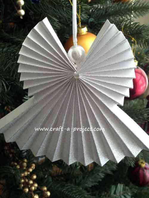 create a christmas angel ornament for your xmas tree this year using paper fun and easy activity for the kids