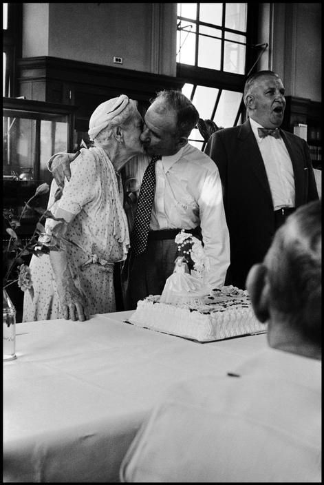 Leonard Freed, USA. New York City. 1956. A wedding couple kiss in an old age home.
