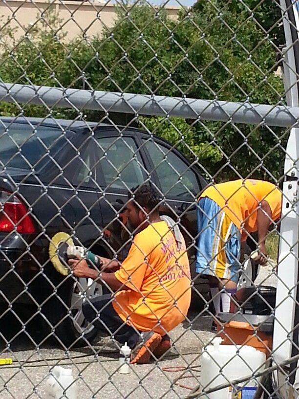 Mobile car wash and Detailing guys detailing clients car to restore paint to its original new cqr show room shine.