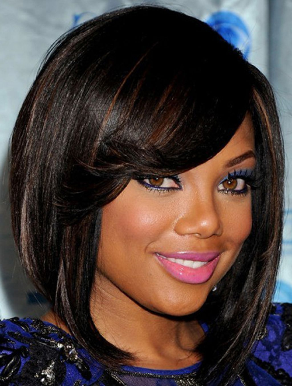 Natural hairstyles for medium length hair for black women - Short Black Haircuts With Bangs The Side Swept Wispy Bang And